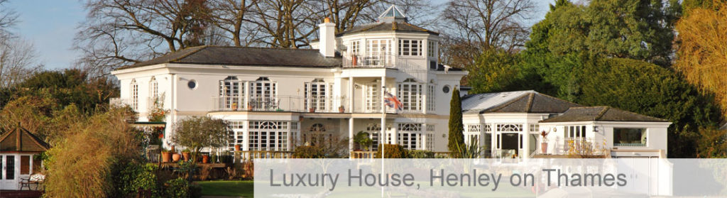 3 storey luxury white house on Henley on Thames surrounded by trees in autumn