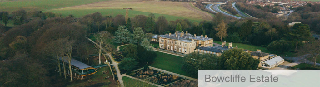 Aerial view of historic country estate Bowcliffe Hall surrounded by trees and countryside with modern outside space